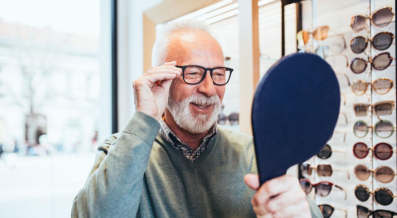 man trying on glasses frames